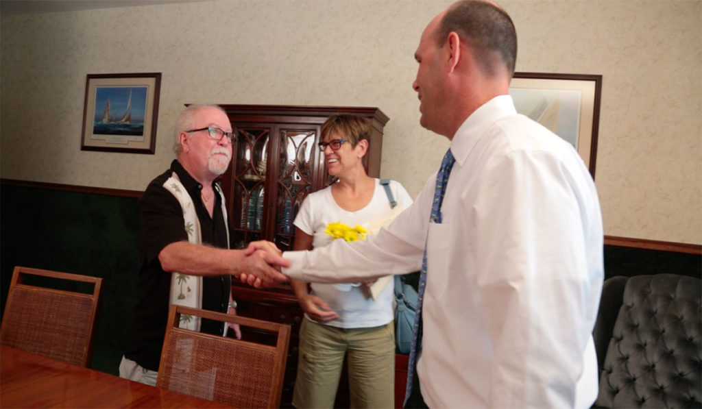 Estate attorney Mike Mastry meets with happy clients.